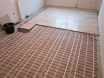 Укладка плитки поверх нагревательных матов