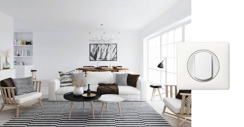 Выключатель Legrand Celiane в белой классической рамке в квартире в скандинавском стиле